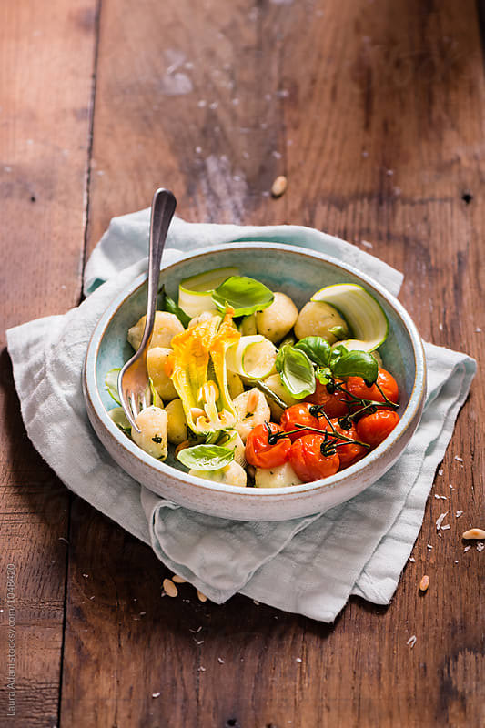 Gnocchi with basil, tomatoes and vegetables by Laura Adani for Stocksy United