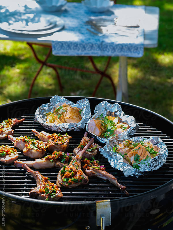 Lamb chops and salmon on the grill by J.R. PHOTOGRAPHY for Stocksy United