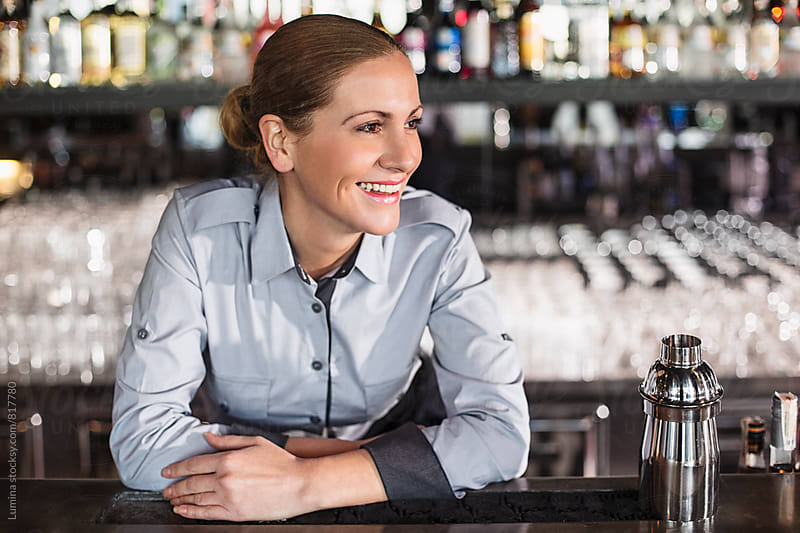 Happy Barmaid Behind the Bar by Lumina for Stocksy United