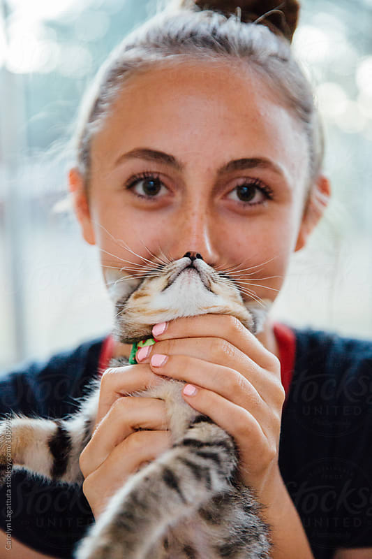 Teenage girl with a cat face by Carolyn Lagattuta for Stocksy United