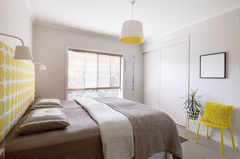 Interior of contemporary styled bedroom by Rowena Naylor for Stocksy United