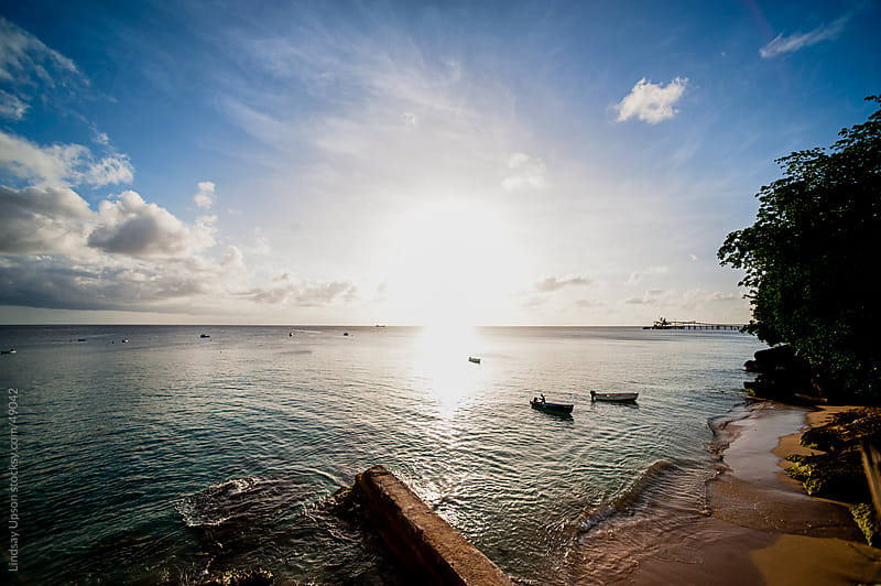 Barbados at sunset with 2 boats by Lindsay Upson for Stocksy United