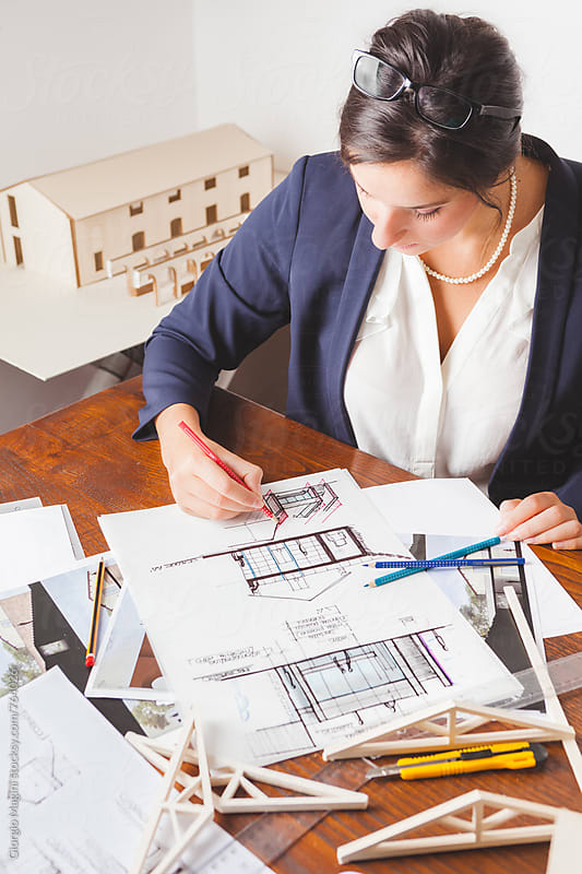 Young Female Architect Sketching Housing Designs by Giorgio Magini for Stocksy United