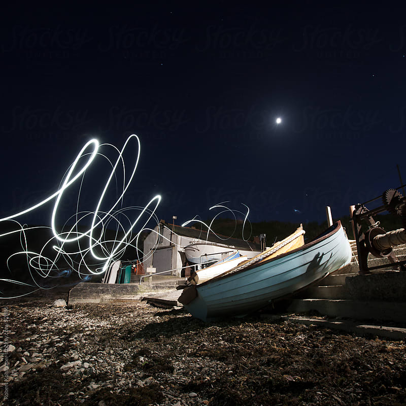 Small harbour with boats and lightpainting at night by Robert Kohlhuber for Stocksy United