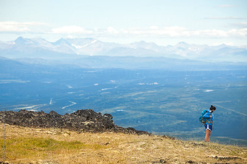 Hiker Descends Mountain Top by Willie Dalton for Stocksy United