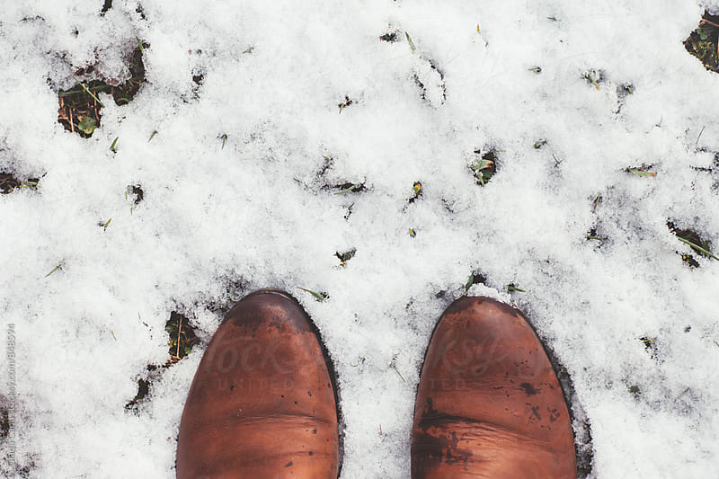 Leather shoes in the snow by Giada Canu for Stocksy United