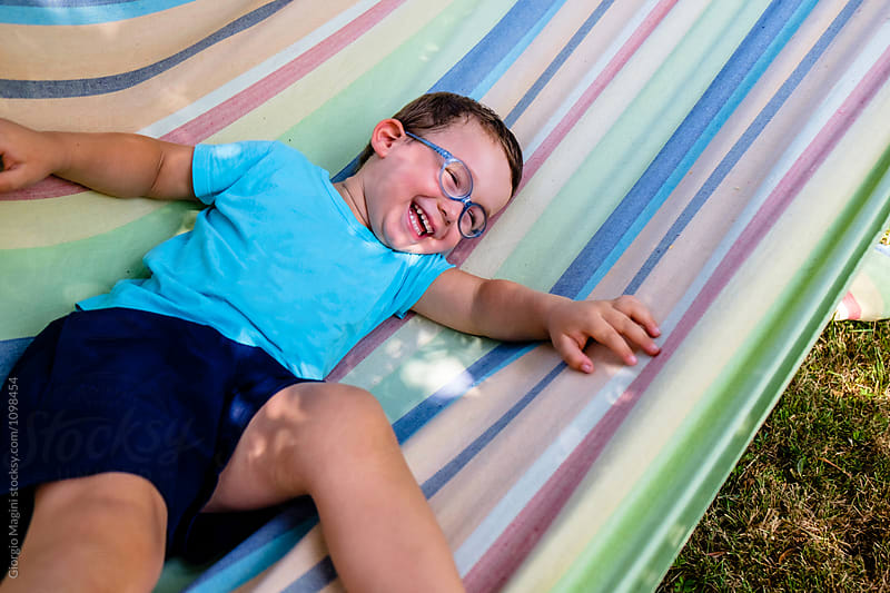 Happy Toddler Boy on an Hammock Outdoors by Giorgio Magini for Stocksy United