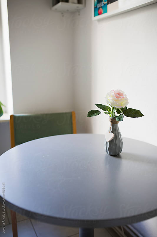 Kitchen table with rose in a vase by Jovana Rikalo for Stocksy United