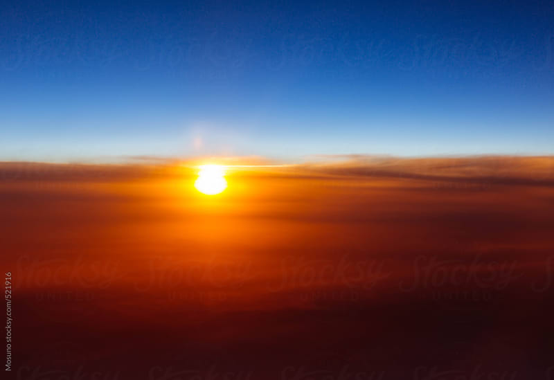 Vibrant Sunset Through the Dust and Clouds by Mosuno for Stocksy United