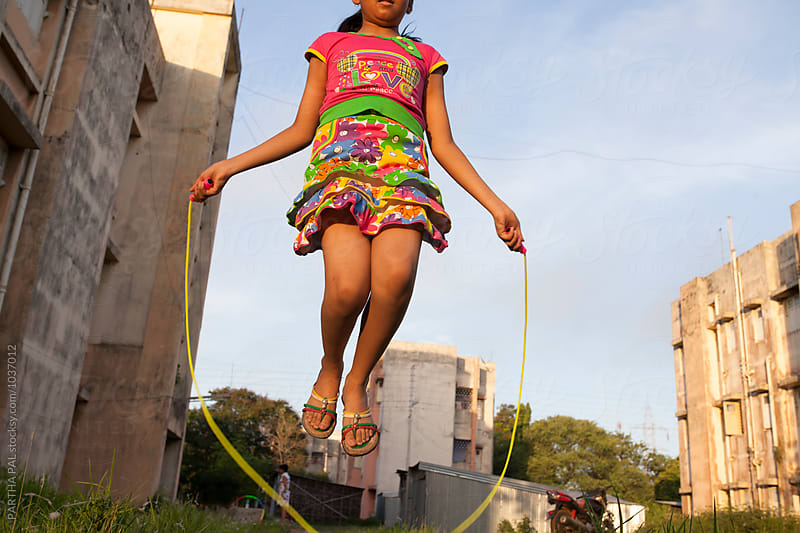 Teenage Girl playing and making fun with jumoing rope by PARTHA PAL for Stocksy United