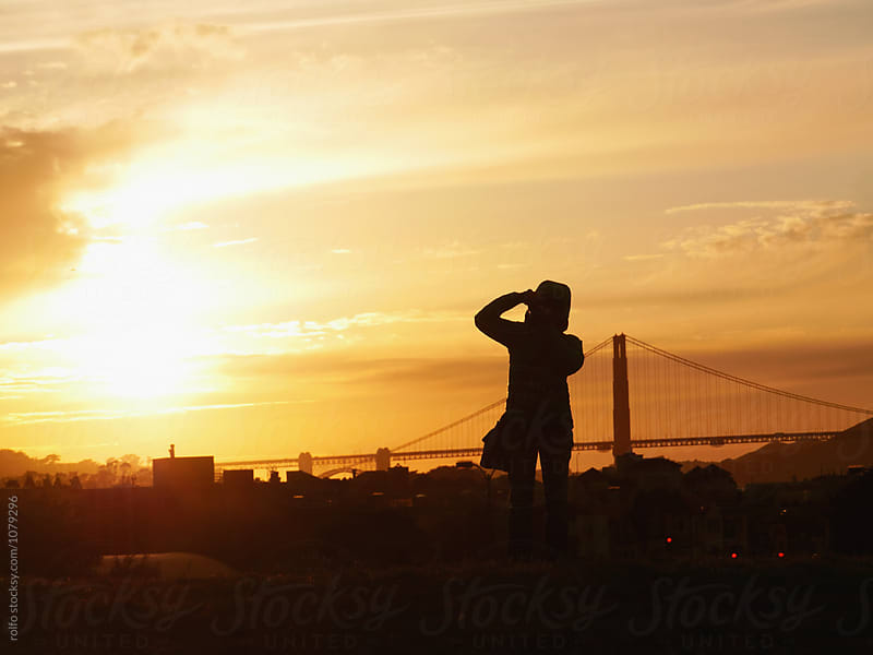 Person photographing Golden Gate Bridge at sunset by rolfo for Stocksy United