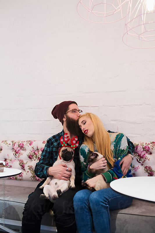 Happy couple with their pets by Jovana Rikalo for Stocksy United