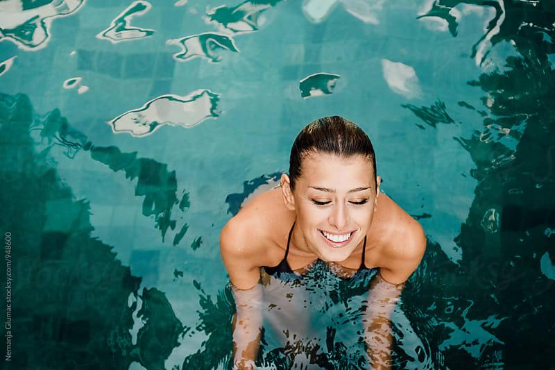 Pretty Woman Smiling in the Pool by Nemanja Glumac for Stocksy United