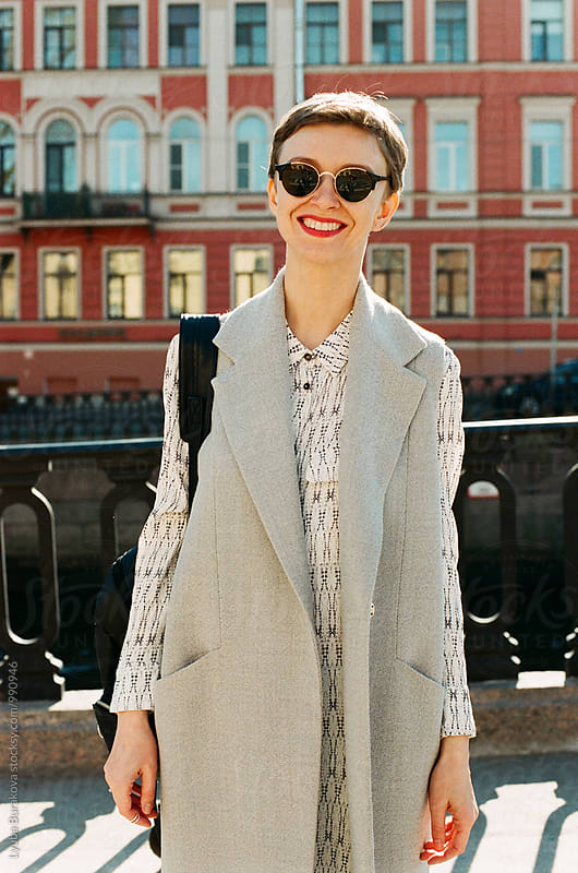 Happy stylish woman at the street by Liubov Burakova for Stocksy United