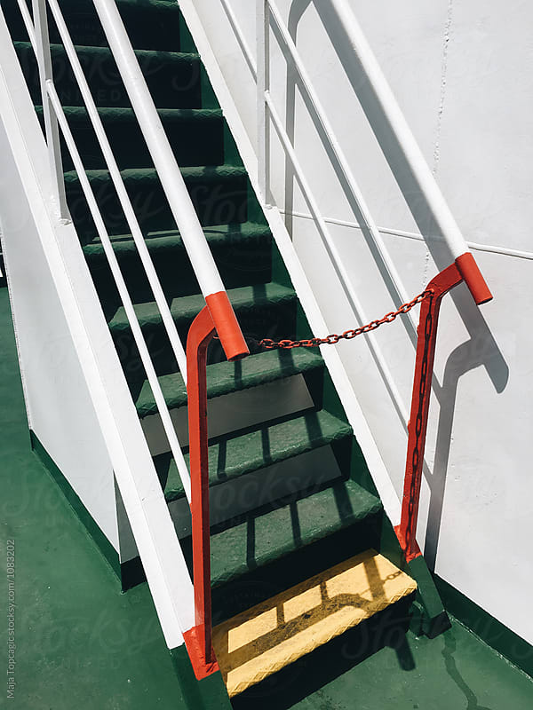 Cute colorful stairs on a ferry boat by Maja Topcagic for Stocksy United