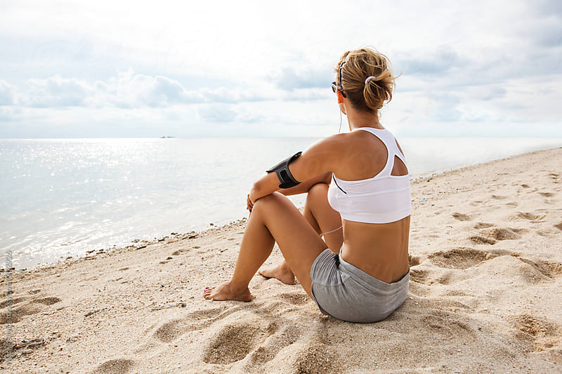 Woman Resting after Jogging at the Beach by Marija Savic for Stocksy United