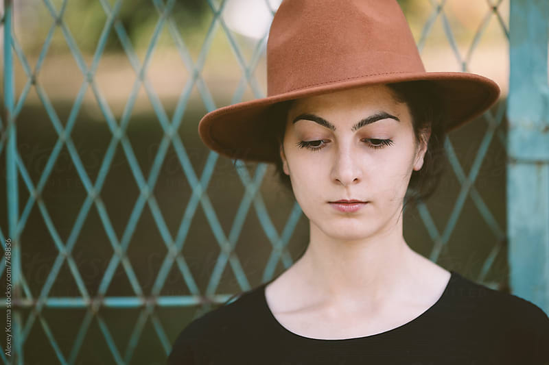 portrait of young woman with hat . by Alexey Kuzma for Stocksy United