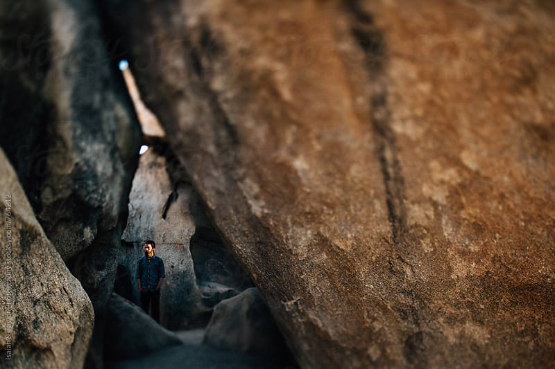 Young Man in a cave by Isaiah & Taylor Photography for Stocksy United