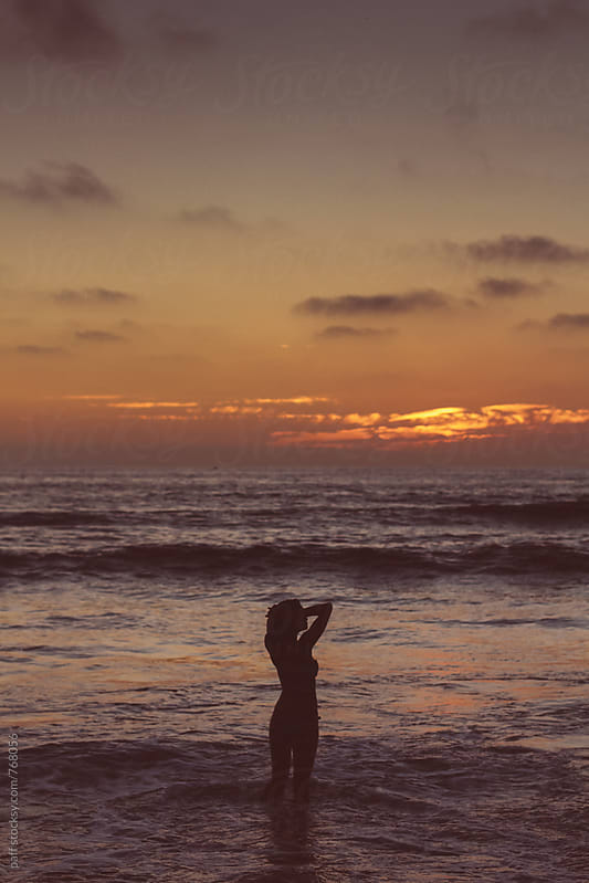 Silhouette of a sexy, hot girl on the beach at sunset by paff for Stocksy United