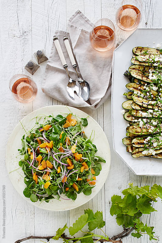 Arugula salad with rose wine by Trinette Reed for Stocksy United