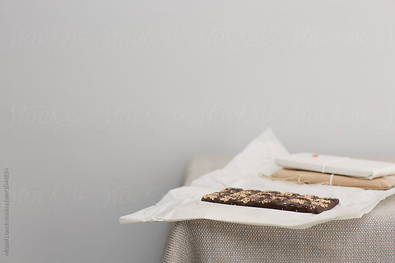 Artisan chocolate on a table by Miquel Llonch for Stocksy United