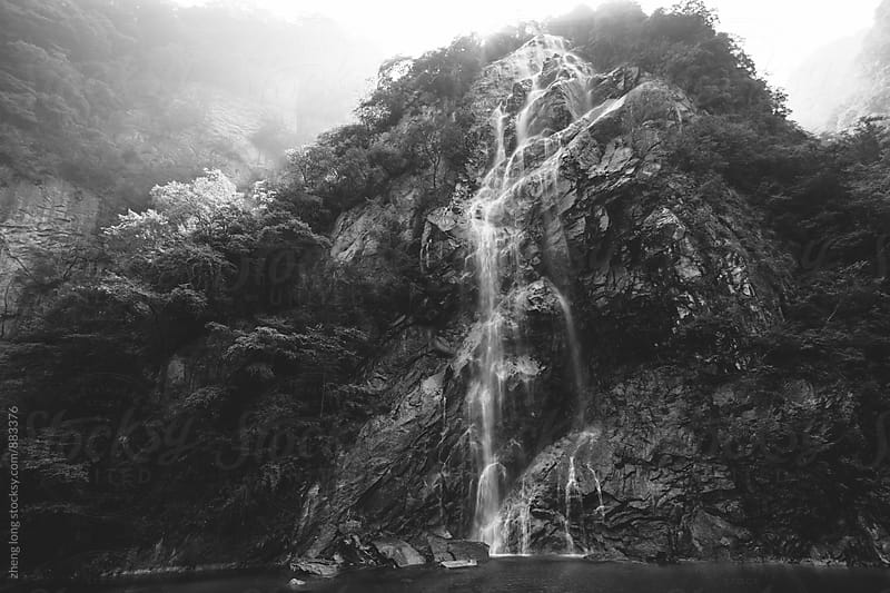 waterfall in the mountain by zheng long for Stocksy United