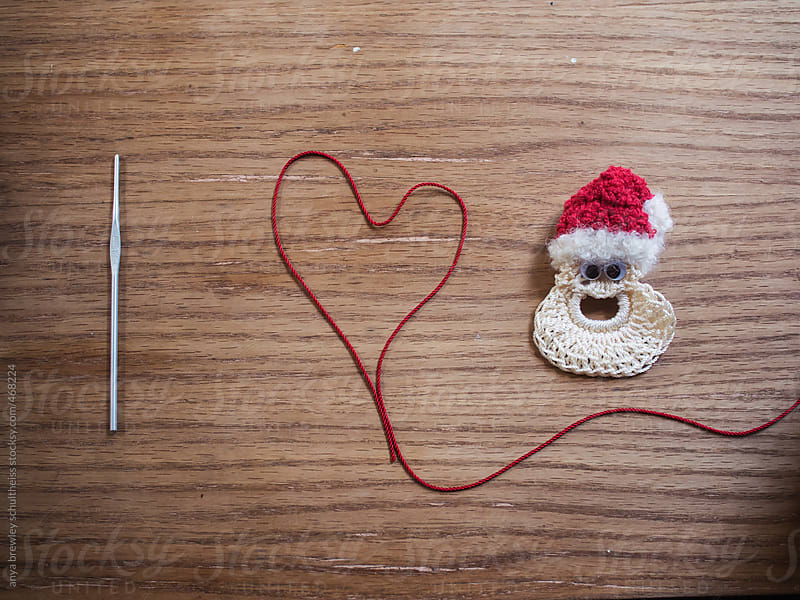 Image of I love Santa spelled out in yarn and a crochet hook by anya brewley schultheiss for Stocksy United