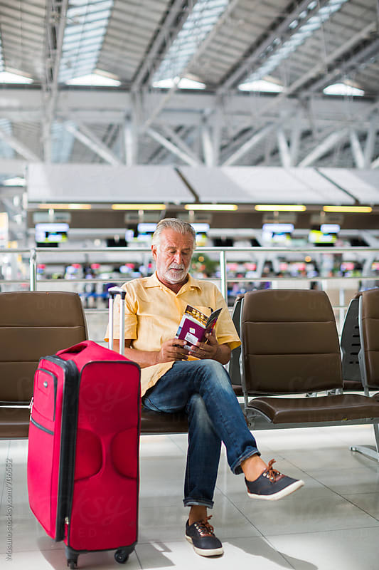 Senior Man Sitting at the Airport Gate by Mosuno for Stocksy United