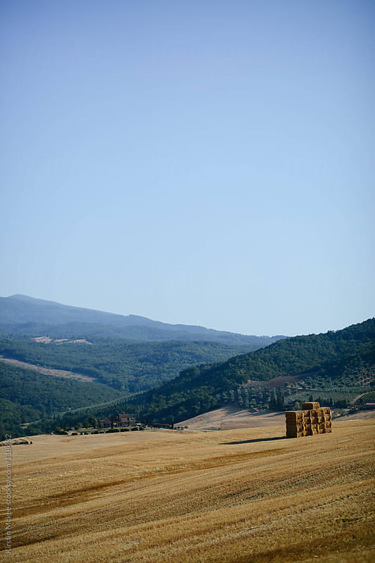 Bales of hay in Tuscany. by Kirstin Mckee for Stocksy United