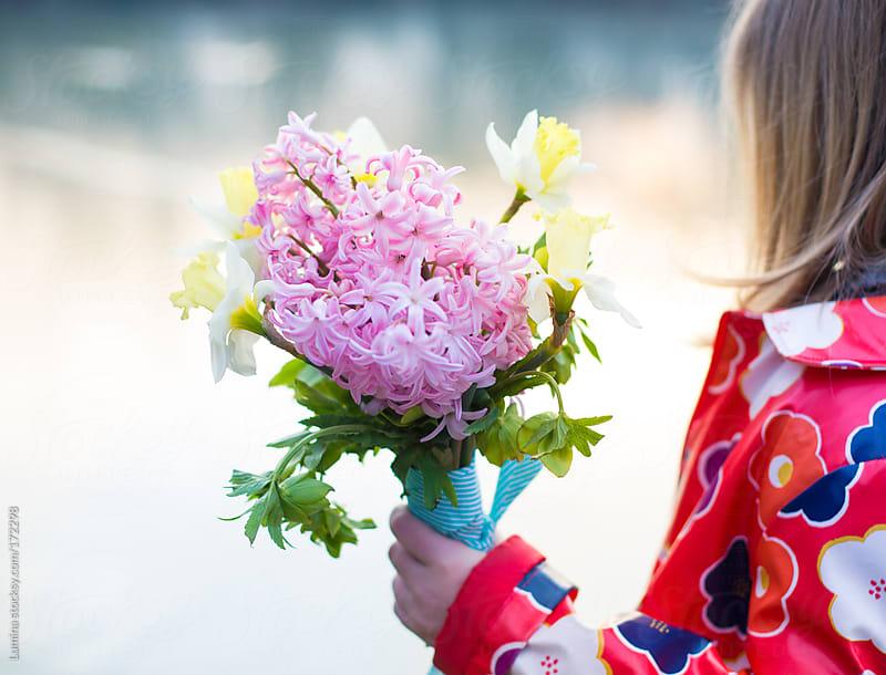 Girl Holding Flowers by Lumina for Stocksy United