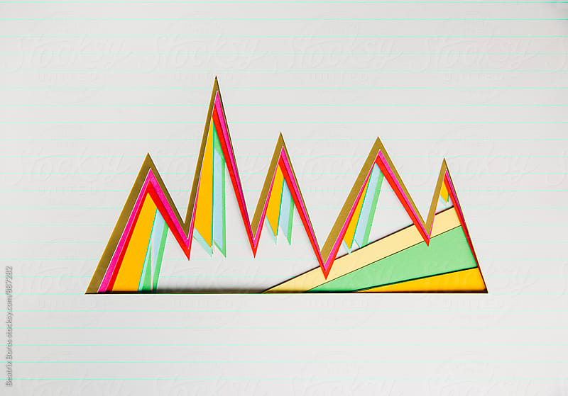 Graphs for accounting made of paper by Beatrix Boros for Stocksy United