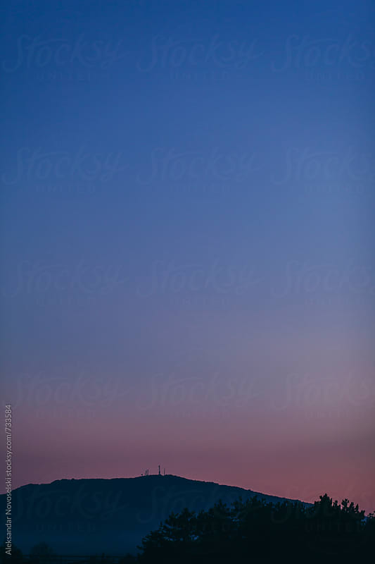 Mountain landscape by dusk with nice pink-blue sky by Aleksandar Novoselski for Stocksy United