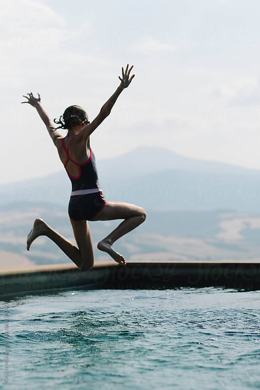 Girl jumping into pool by Kirstin Mckee for Stocksy United