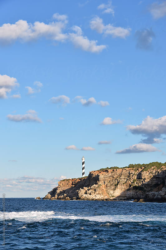Lighthouse in the cliffs of Ibiza by Bisual Studio for Stocksy United