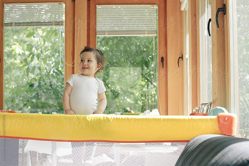 Girl smiling in her crib by Ani Dimi for Stocksy United