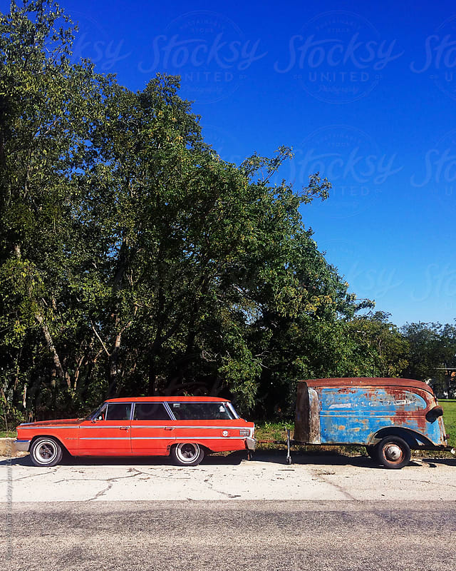 Vintage red car and trailer on street by Nicole Mlakar for Stocksy United