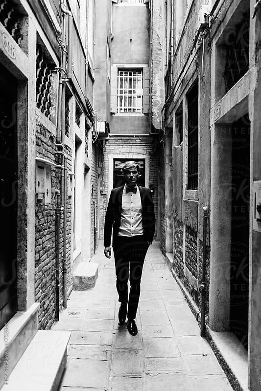 Elegant Young Man Walking in Venice Italy by Mattia Pelizzari for Stocksy United