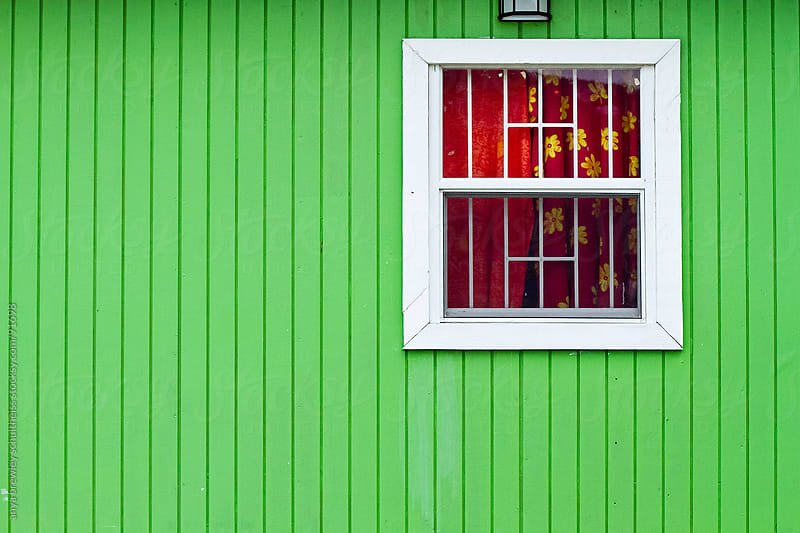 Green wooden wall with window with red curtains by anya brewley schultheiss for Stocksy United