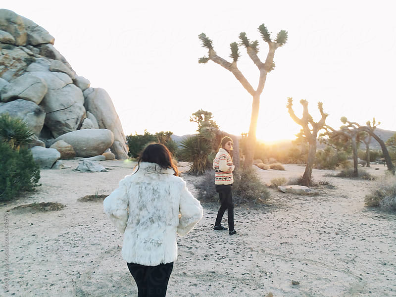 Friends Walking into the Desert Sunset by Kevin Russ for Stocksy United