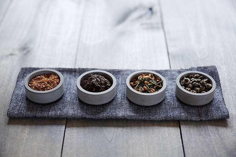 Various loose leaf teas in concrete bowls by Trinette Reed for Stocksy United