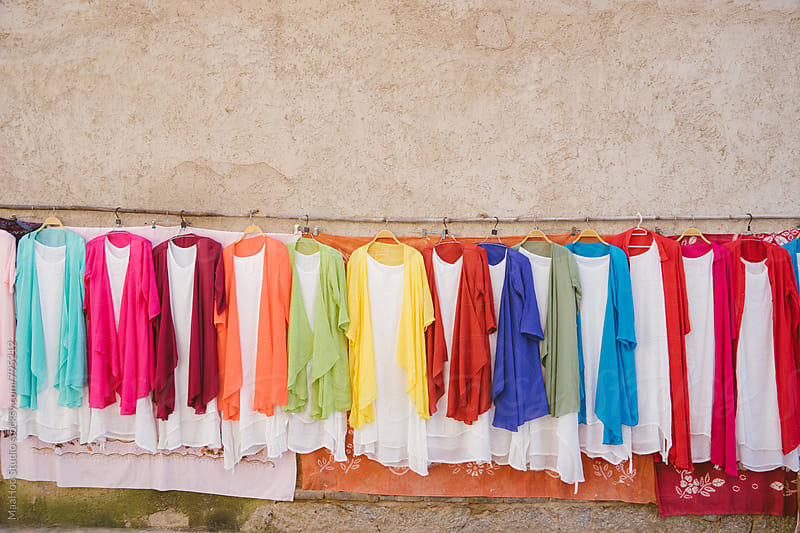 Cloths displayed in a Chinese local market by MaaHoo Studio for Stocksy United