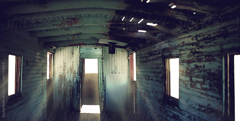 Rays of light in an abandoned train car  by Rachel Bellinsky for Stocksy United
