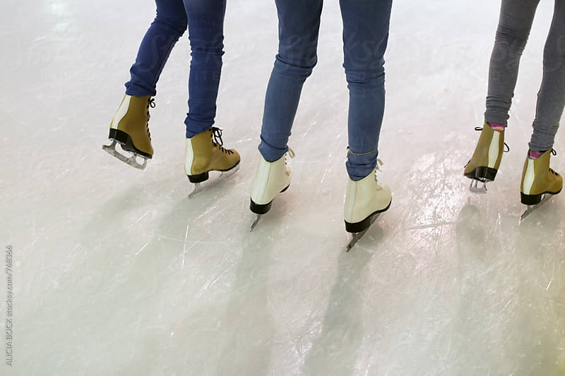 The Ice Skates Of Three Friends Skating Together On A Winter Afternoon by ALICIA BOCK for Stocksy United