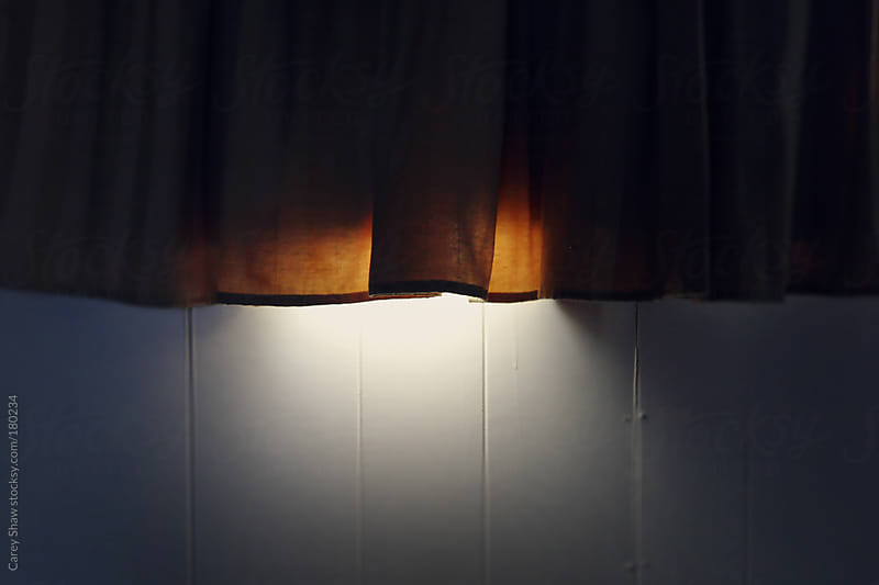 Light peaking through window curtain by Carey Shaw for Stocksy United