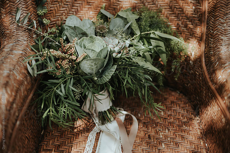 Simple green succulent wedding bouquet with lace ribbon