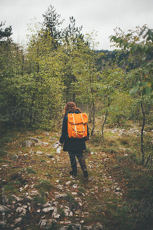Woman With a Backpack Hiking  by Lumina for Stocksy United
