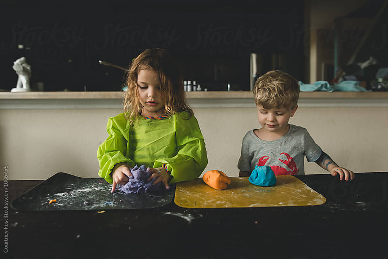 Making dough for school time activity  by Courtney Rust for Stocksy United