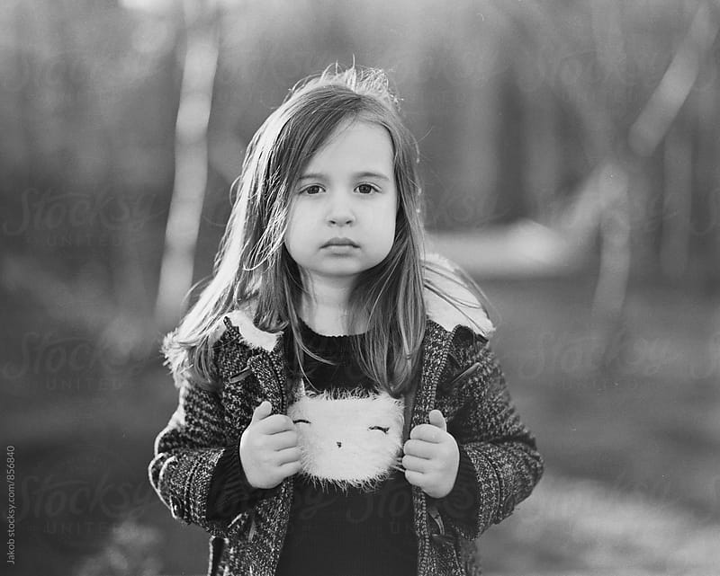 Portrait of a serious looking young girl in a coat by Jakob for Stocksy United