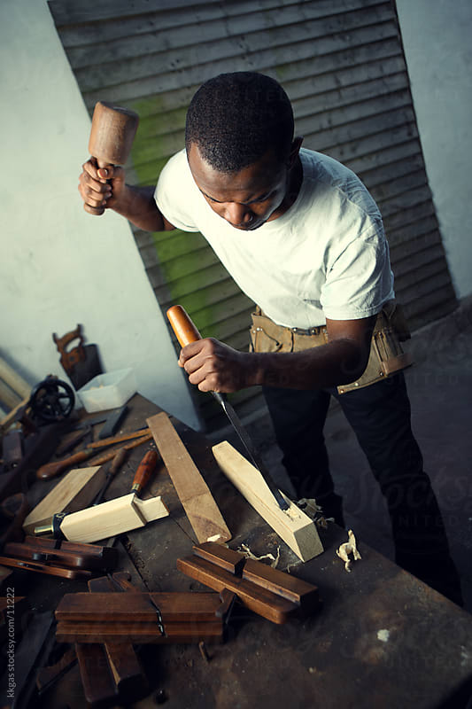 Young carpenter using a chisel. by kkgas for Stocksy United
