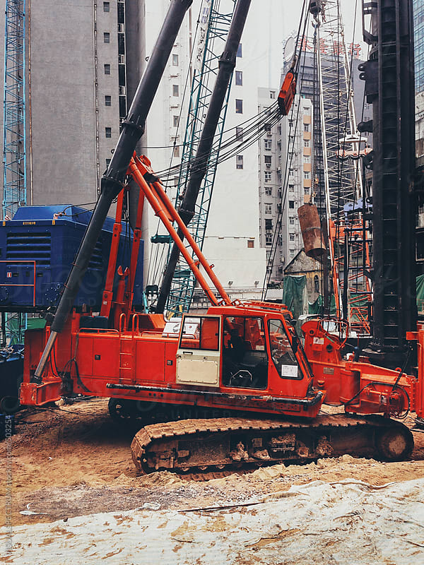 Red Crane on Hong Kong Construction Site by VISUALSPECTRUM for Stocksy United